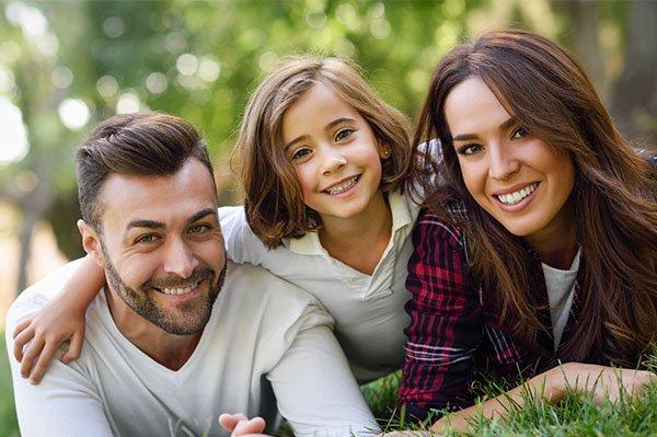Smiling Family Outdoor | Dentist Thornton