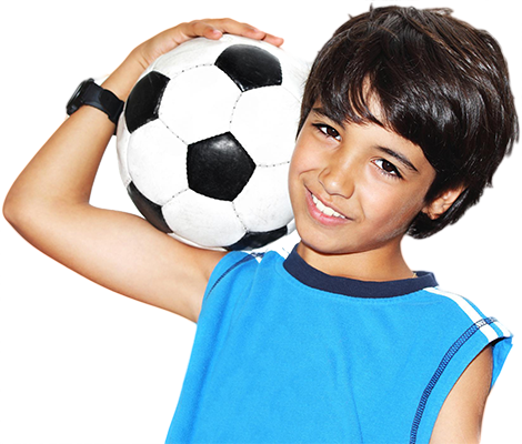 Cute boy playing football | Dentist Thornton